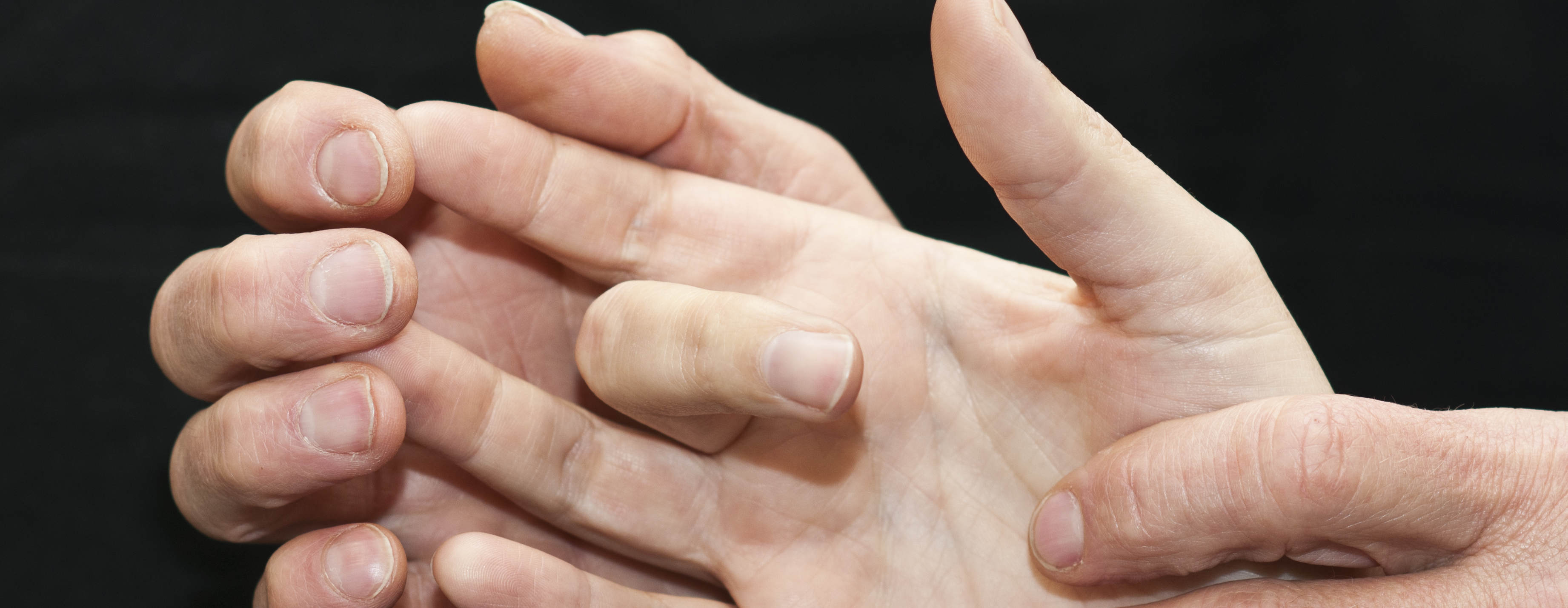 Researcher touches fingers and palm of participant in a study of sensory perception