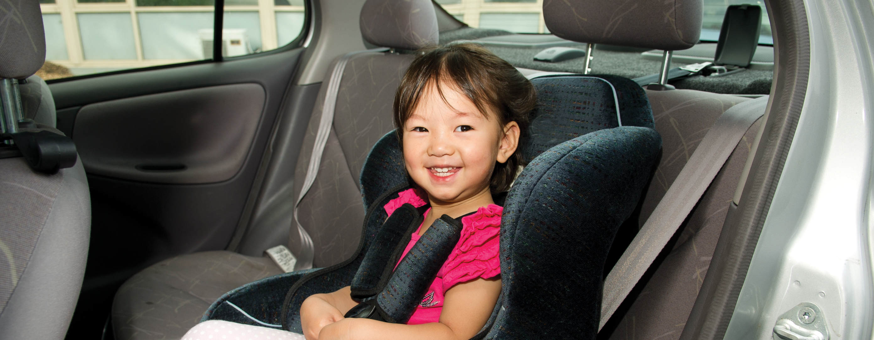 Young girl in rear child restraint seat