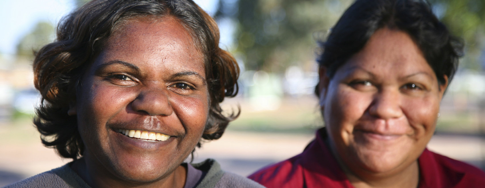 Two Aboriginal women smiling