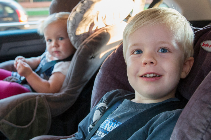 Two young children in child restraint seats