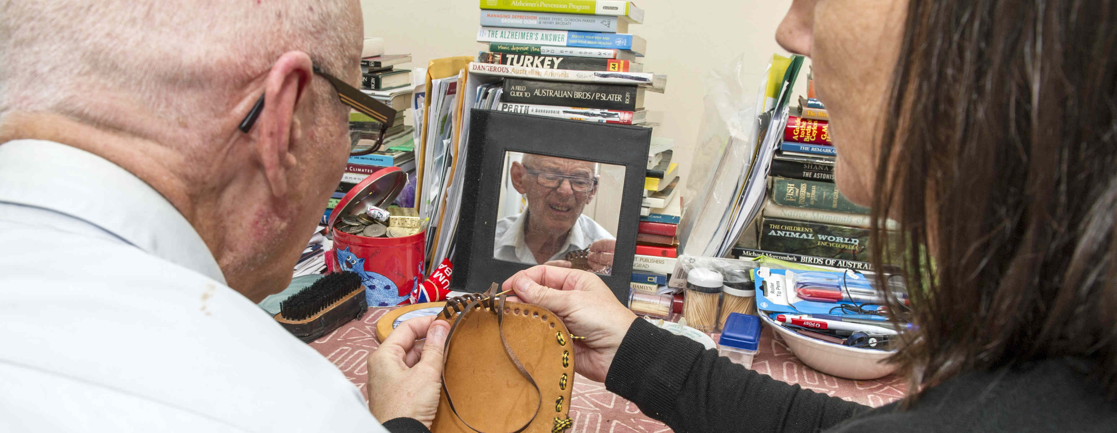 Researcher helps participant in study that improves cognition in elderly