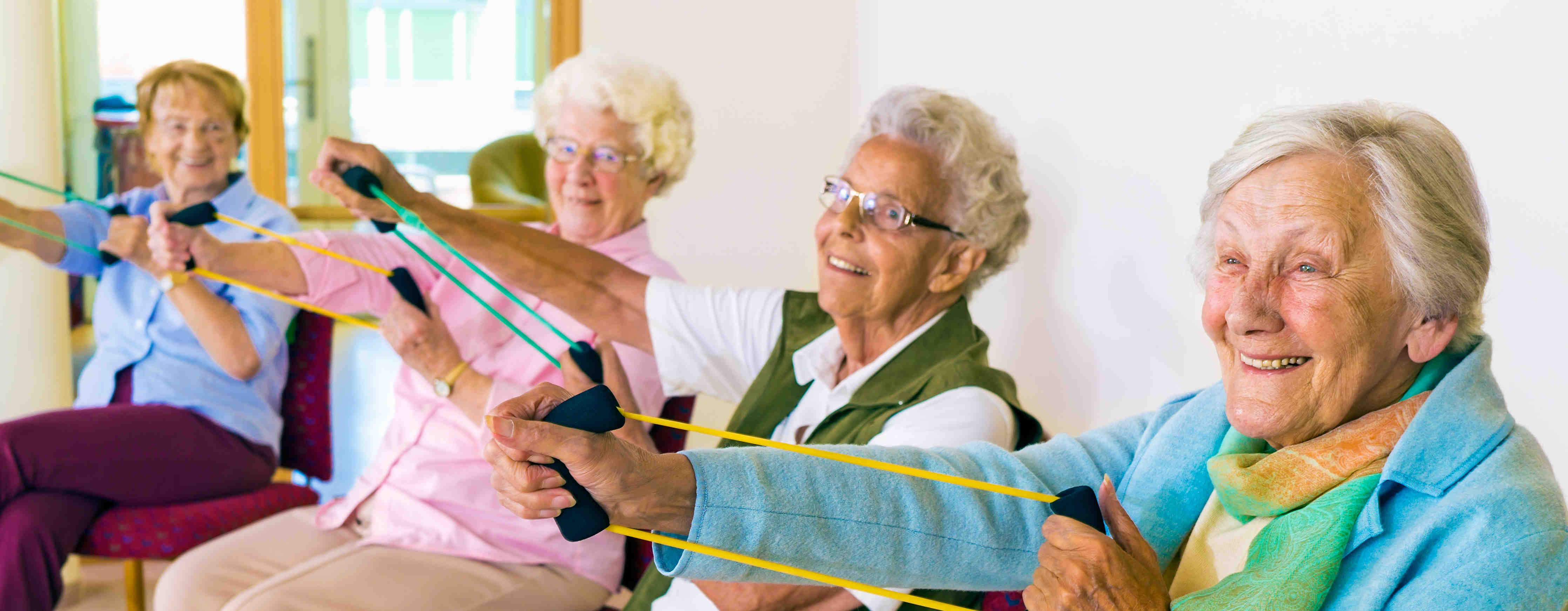 Elderly women use elastic bands for stroke rehab