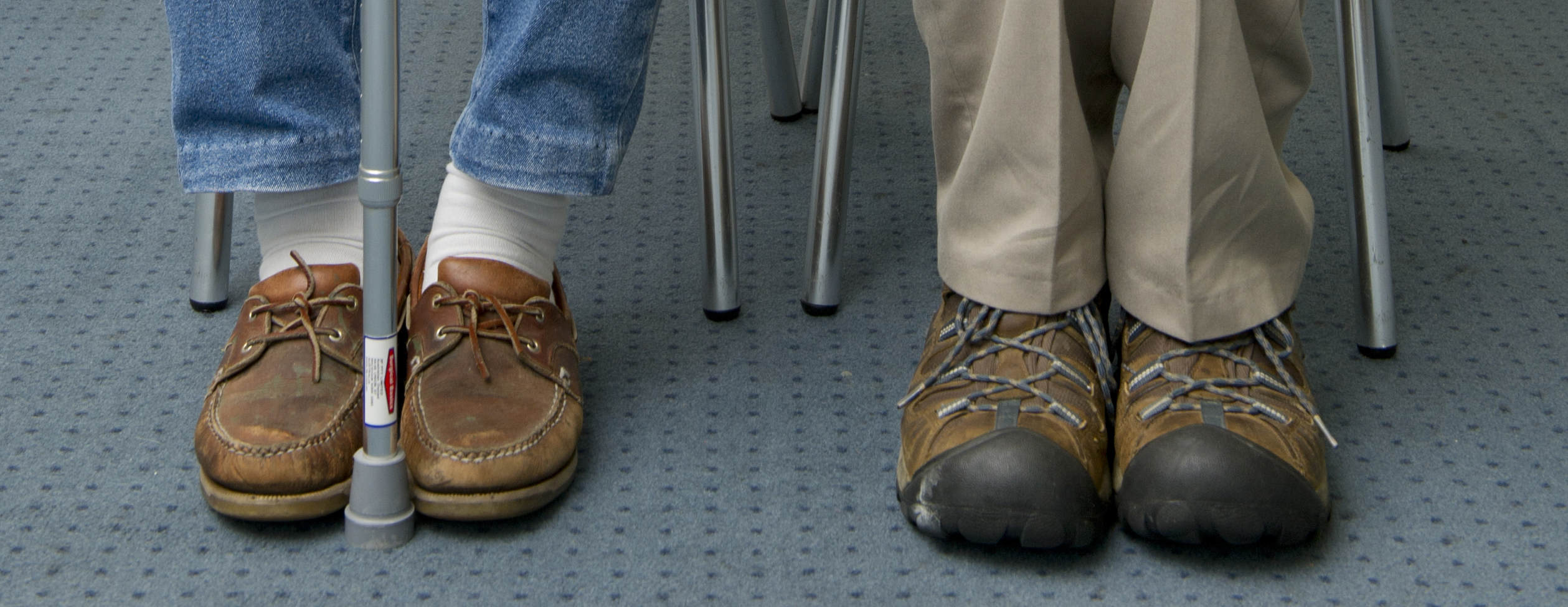 Feet of two elderly men